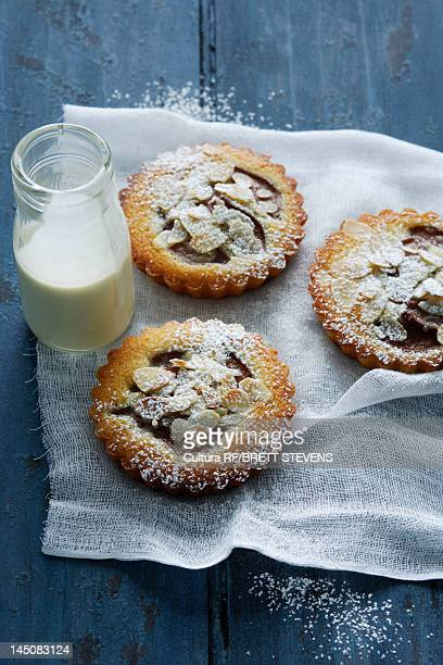 Almond tarts with milk on board