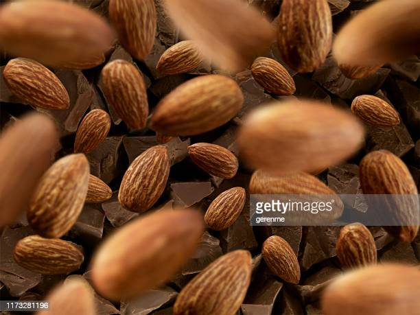 almonds and chocolate - almond stock pictures, royalty-free photos & images