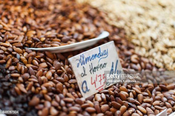 almonds and other nuts for sale on display on a counter - istock photo stock pictures, royalty-free photos & images