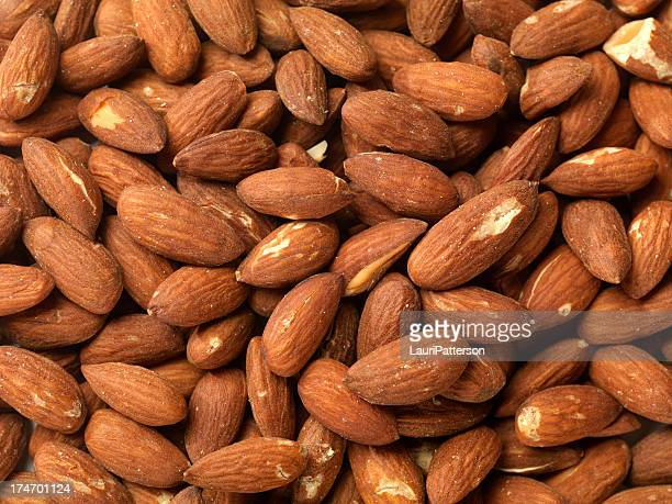almonds background - salted stock pictures, royalty-free photos & images