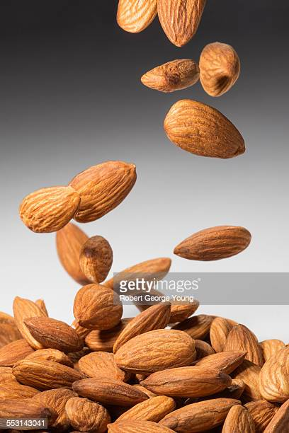 Almonds falling into pile