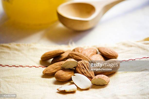Almonds, honey jar on kitchen cloth