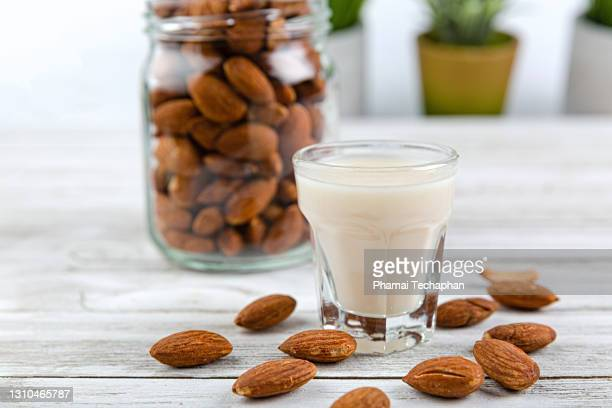 almonds in a jar, a glass of almond milk - 亜鉛 ストックフォトと画像