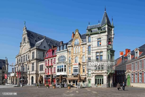 Almost completely deserted Saint-Bavo's square, empty due to 2020 COVID-19 / coronavirus / corona virus pandemic in the Flemish city Ghent, Belgium.