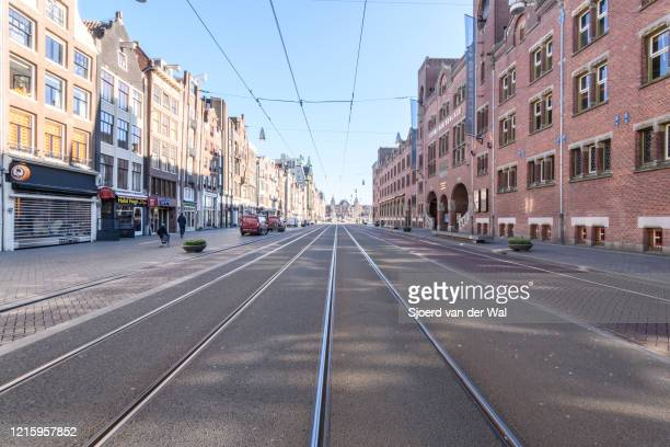 Almost deserted Damrak street in Amsterdam during a weekday morning following the advice of the Dutch government to stay at home for prevention of...