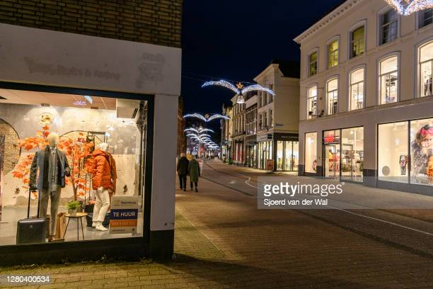 Almost deserted Diezestraat shopping street in the city center of Zwolle during the weekly shopping evening after the Dutch government announced new...