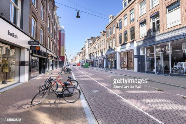 Almost deserted hs Pieter Cornelisz Hooftstraat luxury shopping street in Amsterdam during a weekday morning following the advice of the Dutch...