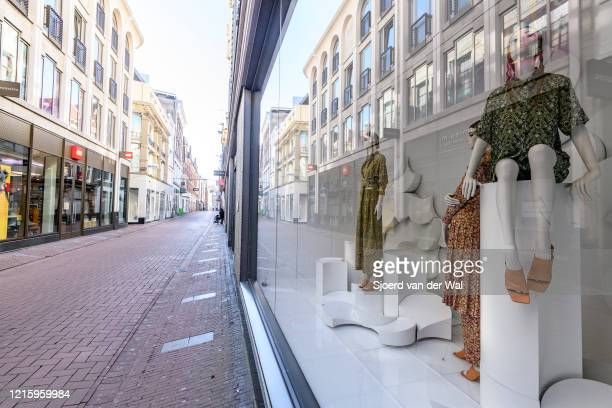 Almost deserted Kalverstraat shopping street in Amsterdam during a weekday morning following the advice of the Dutch government to stay at home for...