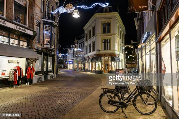 Almost deserted Luttekestraat shopping street in the city center of Zwolle during the weekly shopping evening after the Dutch government announced...