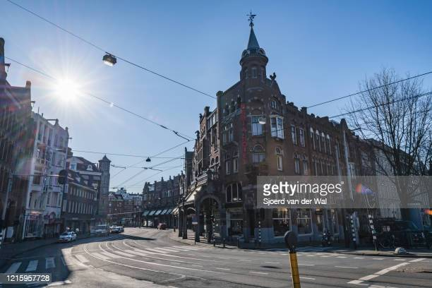 Almost deserted Raadhuisstraat street in Amsterdam during a weekday morning following the advice of the Dutch government to stay at home for...