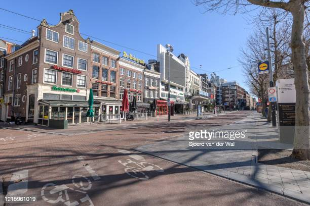 Almost deserted Rembrandtplein square in Amsterdam during a weekday morning following the advice of the Dutch government to stay at home for...