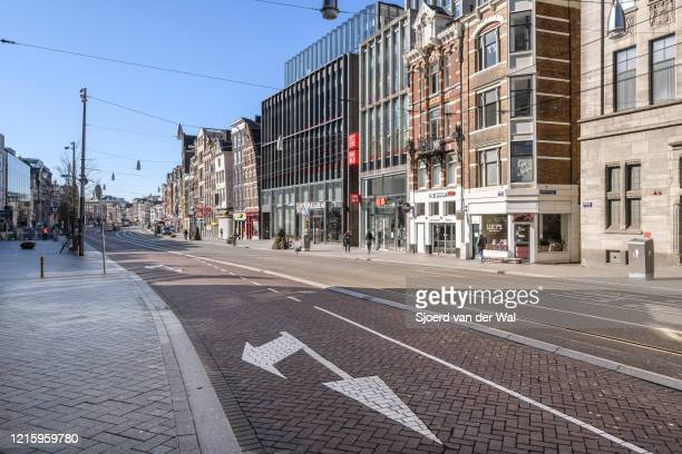 Almost deserted Rokin street in Amsterdam during a weekday morning following the advice of the Dutch government to stay at home for prevention of...