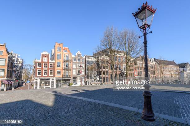 Almost deserted Torensluis bridge at the Singel canal in Amsterdam during a weekday morning following the advice of the Dutch government to stay at...