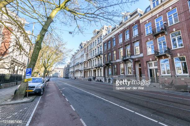 Almost deserted Weteringschans street in Amsterdam during a weekday morning following the advice of the Dutch government to stay at home for...