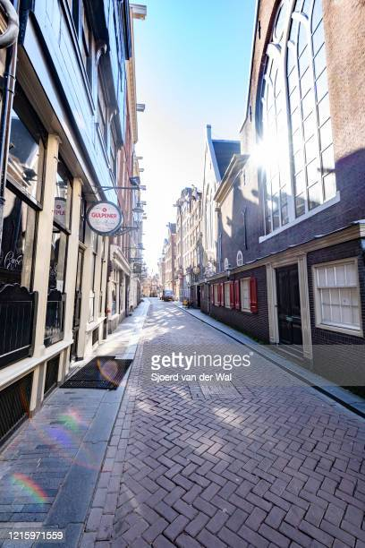 Almost deserted Zeedijk street in Amsterdam during a weekday morning following the advice of the Dutch government to stay at home for prevention of...