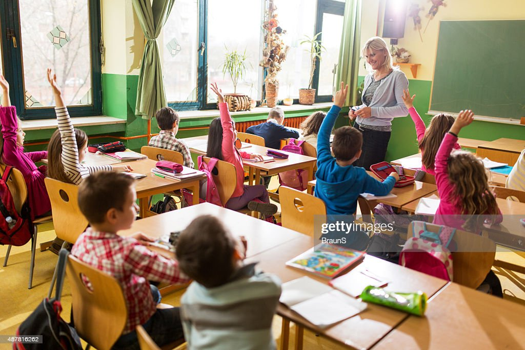 Almost everyone knows the answer to teacher's question. : Stock Photo