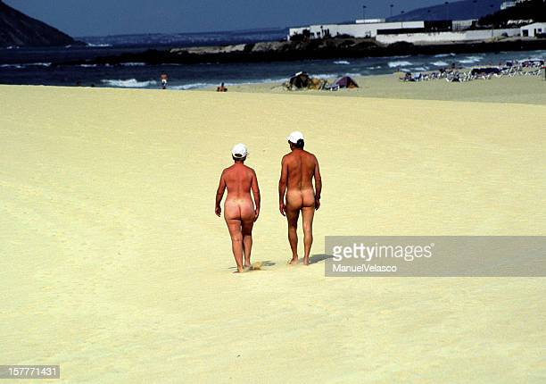 almost naked - naturalist beach stock photos and pictures