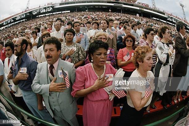 Almost ten thousand new citizens, predominantly Hispanic, pledge allegiance to the United States of America during a naturalization ceremony at...