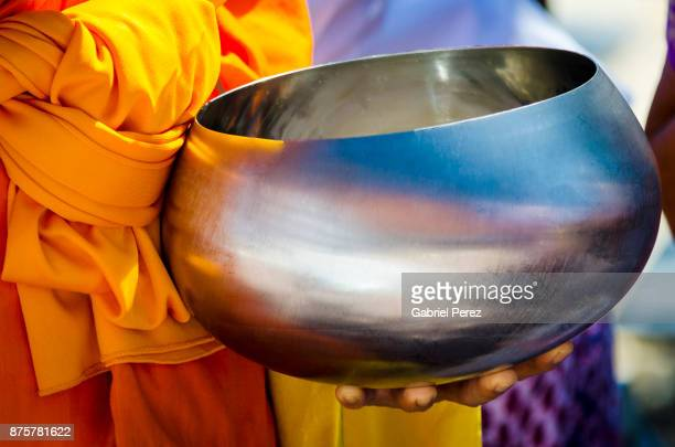 alms giving at a buddhist temple - donate icon stock photos and pictures