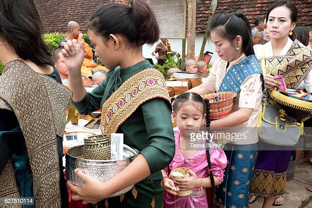 Alms giving at the That Luang festival Vientiane Lao PDR Pha That Luang is the national symbol and most important religious monument of Laos...