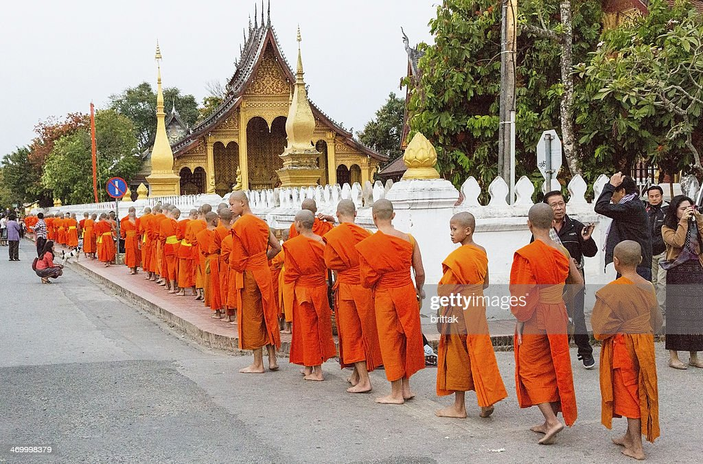 Alms giving early morning in Luang Prabang, Laos. : Stock Photo