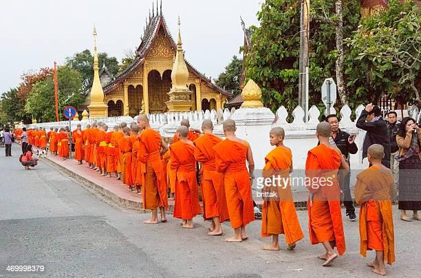 Alms giving early morning in Luang Prabang, Laos.