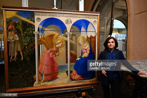"""Almudena Sanchez, restorer of Spanish 'Museo del Prado', poses next to """"The Annunciation"""" retable by Italian painter Fra Angelico following a press..."""