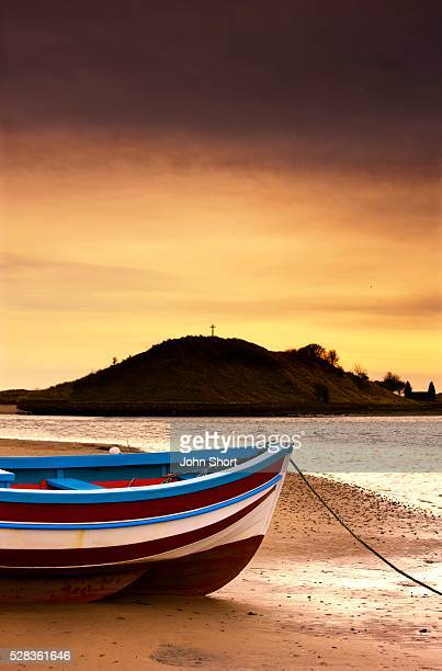 Alnmouth, Northumberland, England; Boat on sunset beach