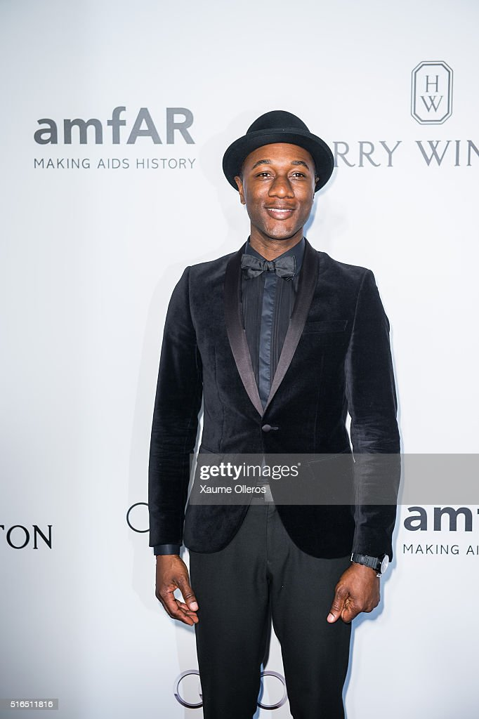 Aloe Blacc attends the 2016 amfAR Hong Kong gala with a guest at Shaw Studios on March 19, 2016 in Hong Kong, Hong Kong.