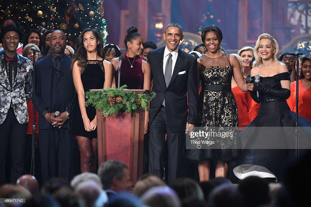 Aloe Blacc, Darius Rucker, Malia Obama, Sasha Obama, U.S. President Barack Obama, First Lady Michelle Obama, and Rita Ora speak onstage at TNT Christmas in Washington 2014 at the National Building Museum on December 14, 2014 in Washington, DC. 25248_001_0622.JPG