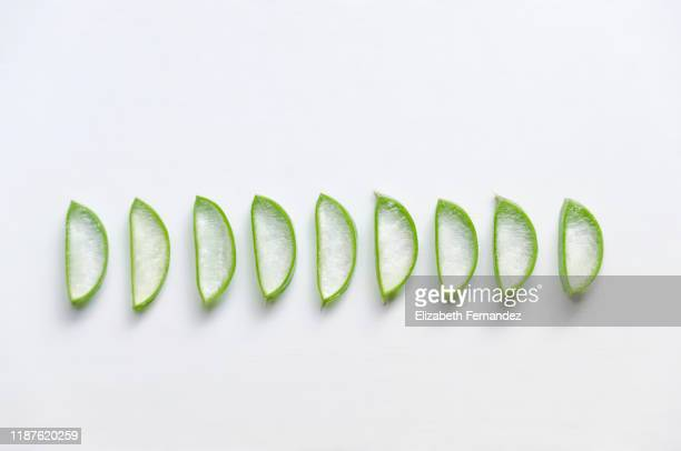 aloe vera slices on white background - aloe stock pictures, royalty-free photos & images