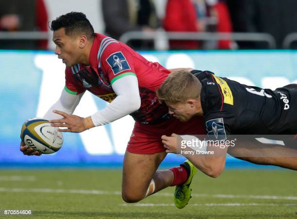 Alofa Alofa of Harlequins and Ben Earl of Saracens during the AngloWelsh Cup round one match between Saracens and Harlequins at Allianz Park on...