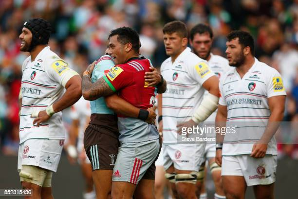 Alofa Alofa of Harlequins celebrates scoring a try with Joe Marchant during the Aviva Premiership match between Harlequins and Leicester Tigers at...