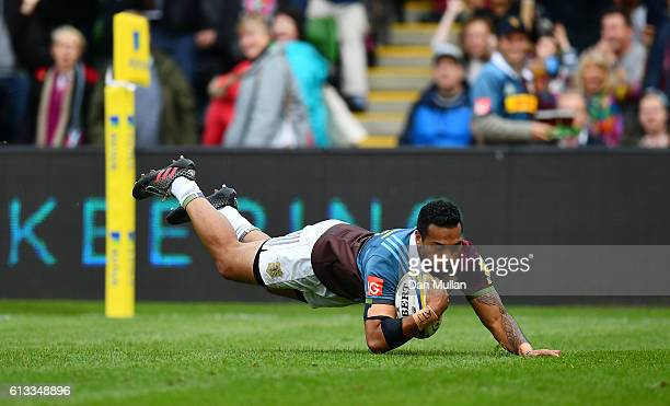Alofa Alofa of Harlequins dives over for the opening try during the Aviva Premiership match between Harlequins and Northampton Saints at Twickenham...