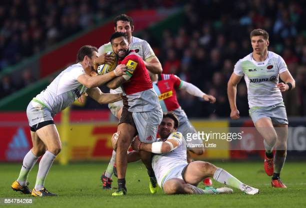 Alofa Alofa of Harlequins is tackled during the Aviva Premiership match between Harlequins and Saracens at Twickenham Stoop on December 3 2017 in...