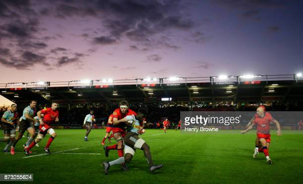 Alofa Alofa of Harlequins tackled by Tom Dodd of Worcester Warriors during the AngloWelsh Cup match between Harlequins and Worcester Warriors at...