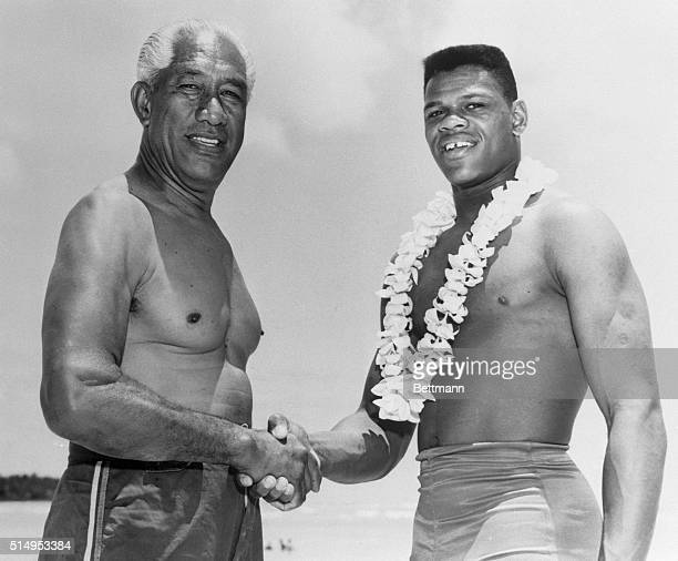 Aloha Honolulu Hawaii Wearing a floral lei decathlon star Milton Campbell of Plainfield New Jersey greets swimming ace Duke Kahanamoku of Hawaii at...