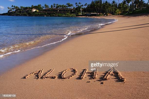 Aloha written in Maui Hawaii resort hotel sand beach