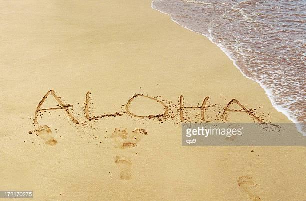 Aloha written in Maui Hawaii sand beach