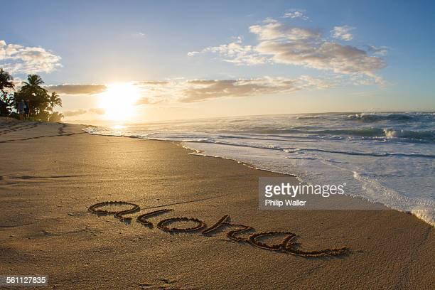 Aloha, written in the sand on beach, Hawaii