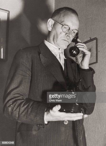 Alois Hitler Jr halfbrother to Adolf Hitler receives a phonecall at his home in Hamburg 17th October 1945 He is often pestered by anonymous callers...
