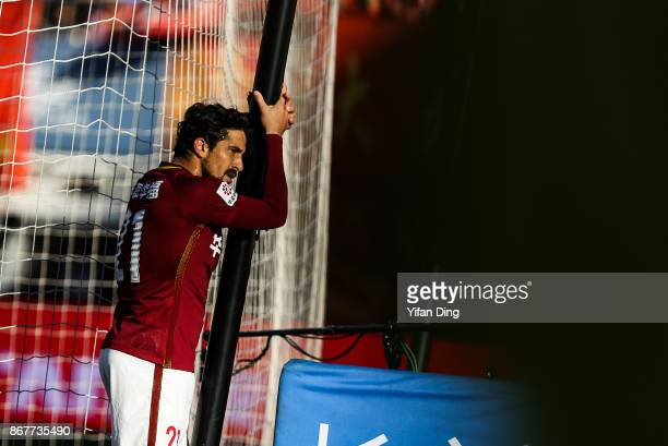 Aloisio dos Santos of Hebei China Fortune reacts after missing a scoring chance during the Chinese Super League match between Hebei China Fortune and...