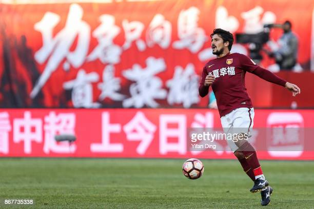 Aloisio dos Santos of Hebei China Fortune reacts during the Chinese Super League match between Hebei China Fortune and Guangzhou Evergrande at...