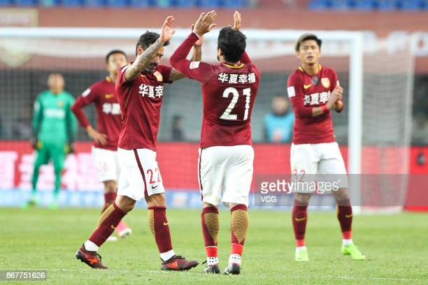 Aloisio of Hebei China Fortune and Ezequiel Lavezzi of Hebei China Fortune celebrate a point during the Chinese Super League match between Hebei...