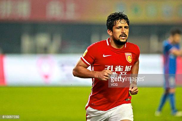 Aloisio of Hebei China Fortune celebrates a ball during the 26th round match of CSL Chinese Football Association Super League on September 26 2016 in...