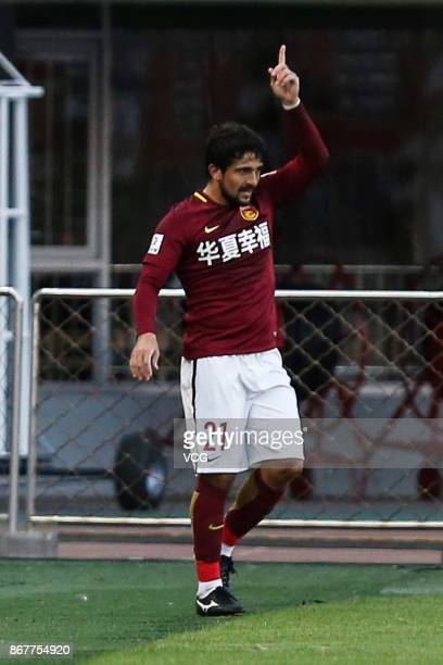 Aloisio of Hebei China Fortune celebrates a point during the Chinese Super League match between Hebei China Fortune and Guangzhou Evergrande at...