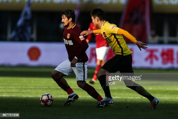 Aloisio of Hebei China Fortune controls the ball during the Chinese Super League match between Hebei China Fortune and Guangzhou Evergrande at...