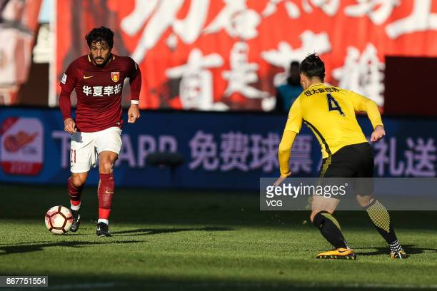 Aloisio of Hebei China Fortune dribbles during the Chinese Super League match between Hebei China Fortune and Guangzhou Evergrande at Qinhuangdao...