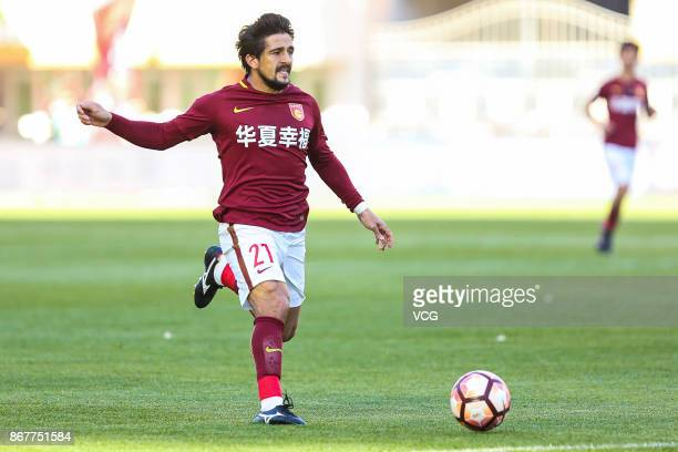 Aloisio of Hebei China Fortune follows the ball during the Chinese Super League match between Hebei China Fortune and Guangzhou Evergrande at...
