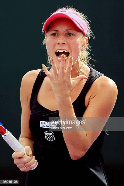 Alona Bondarenko of Ukraine reacts against Gisela Dulko of Argentina during day three of the 2010 Sony Ericsson Open at Crandon Park Tennis Center on...